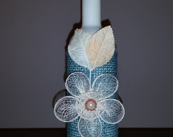 Upcycled vase from a wine bottle in blue and white  with flower