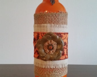 Festive orange bottle vase
