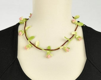 Branch necklace of pink rose buds