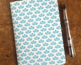 A5 paper journal/notebook featuring a blue and white flower pattern.