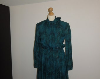 Vintage 1980s green pleated skirt dress with button detail to the front