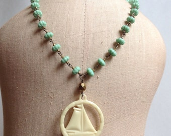 Vintage celluloid Sailboat on sea foam green necklace
