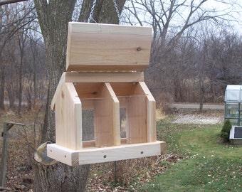 Double seed chamber bird feeder