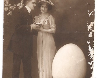 Surreal vintage Easter couple postcard Italian Buona Pasqua egg fertility spring