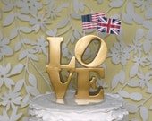 Love wedding cake topper with flags