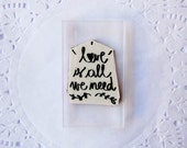rubber stamp love is all you we need mounted on clear acrylic block