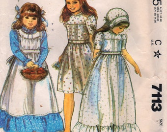 McCalls 7113 1980s Childs Apron Bonnet and Dress Pattern Laura Ashley Girls Vintage Sewing Pattern Size 6  Breast  25