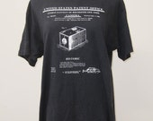 Black tee shirt showing George Eastman Box Camera Patent