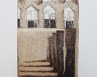 original etching and aquatint of a beach huts and wave breakers