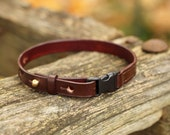 Leather cat collar with safety breakaway buckle