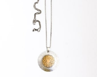 "Large round sterling silver and brass necklace with an intricate pattern hanging from a long opera length silver chain - ""Mandala Necklace"""
