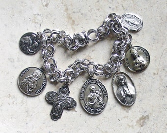 Saints of the Poor...Vintage ELCO Sterling Silver Catholic Medal Saints Bracelet