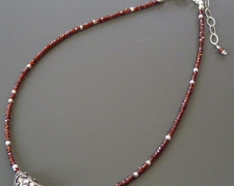 Bright red faceted garnet necklace