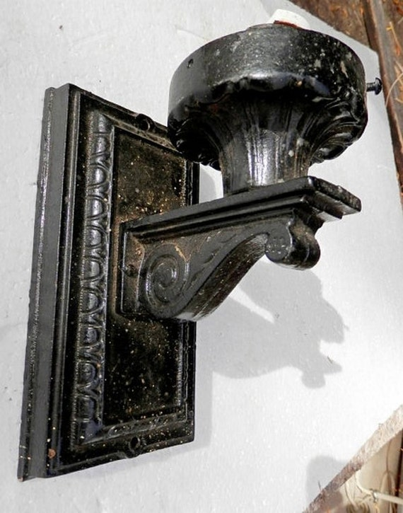 Vintage cast iron outside wall sconce painted black
