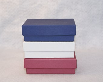 "10 gift boxes -- 3 1/4"" x 2 1/4"" x 1"" -- fiber filled, vibrant colors or glossy embossed white"