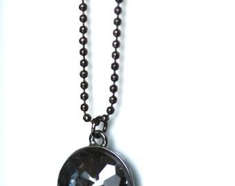 Sparkly round pendant on gunmetal ball chain