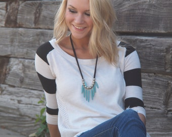 turquoise sticks and black necklace