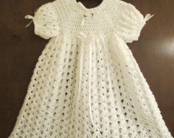 Infant crochet christening dress with matching headband.