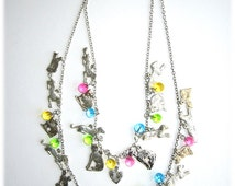 Raining Cats and Dogs Milagro necklace...we could all use a miracle