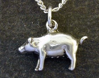 Sterling Silver Pig Pendant on a Sterling Silver Chain.