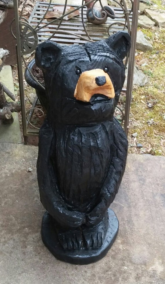 Black bear chainsaw carving made to by bellafolkart