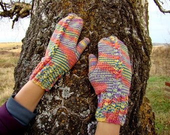 Multicolored cabled knitted pink, orange, yellow, green, blue and violet gloves