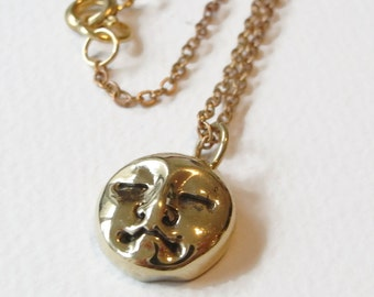 The Man in the Moon: delicate brass charm pendant strung on brass chain