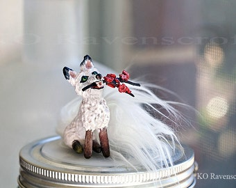 Small fox with a sakura branch / white fox sculpture