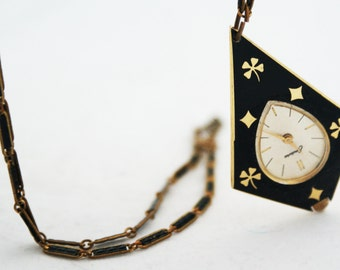 Necklace- Endura Long Clock Black Gold Handing Pendant