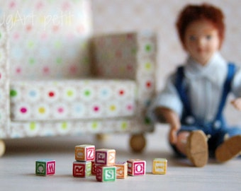 One wooden toy cube with letters