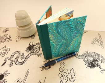 """Small handmade blank book with hand-marbled covers: """"Dreaming"""".  Journal, diary, travel book for creative writing."""