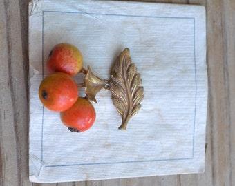 Pretty antique NOS art deco gold tone leaf brooch with orange fruit cluster
