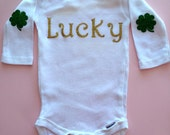 Gold Glitter LUCKY onesie with green glitter shamrock four leaf clover elbow patches