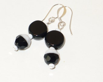 Czech black and white bead with a jet black disk bead earring.