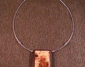 Wood pendant of flame box elder framed with walnut P004