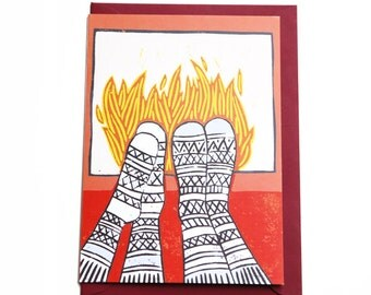Christmas card with illustration near the fire