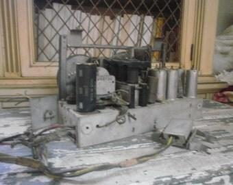 Steampunk Art Radio Parts form a Motorola Stereo Radio Console