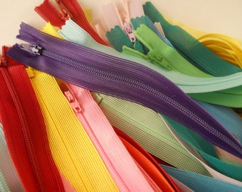ZIPPERS:  SET of 66 ZIPPERS, 20 inch closed end, beulon, mixed colors.