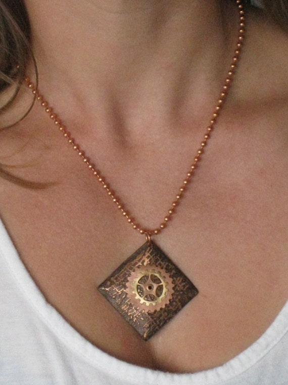 Double wheel in a square - Handmade pendant made of copper and brass