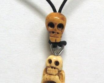 Unusual Handmade Bone Crouching Skeleton on a Bone Skull Necklace 01