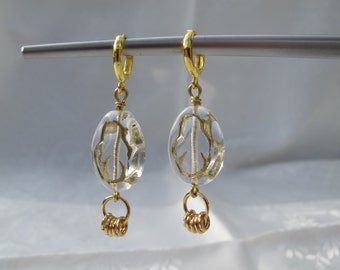 Dangling Transparent Glass Beads. Handmade Earrings of Golden color combined with Beautiful transparent glass beads.