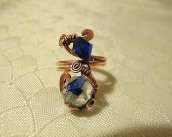 Blue and Transparent Ring. Handmade Ring set with Deep Blue and Transparent Glass Beads. Copper Wire Wrapped Ring. Spiral .