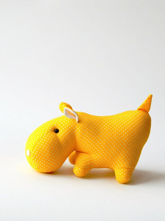 Yellow toy hippo. Stuffed animal. Fabric hippo.