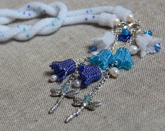 Beaded crocheted lariat necklace decorated with bluebells and dragonflies