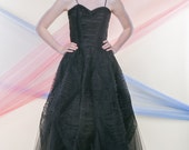 EVELYN (Size 1-2): Glamorous layered black gown with spaghetti straps and layer upon layer of ruched tulle