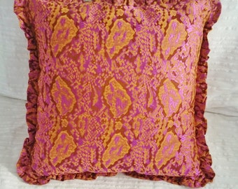 Brocade cushion, pink and light brown, edged with flounce.  Cover in brocade, insert sold apart.