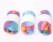 rainbow cotton yarn, crocheting yarn, multicolor knitting, embroidery, tassels, pom poms,  thread, blue, orange, pink, yellow ombre yarn