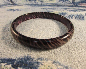 1980s does 1950s purple zebra-patterned acrylic bangle