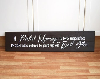 A Perfect Marriage Is Two Imperfect People Who Refuse To Give Up On Each Other - Long Wooden Sign