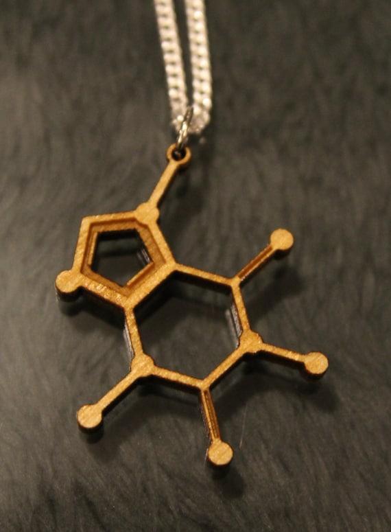 laser cut caffeine molecule necklace by sorceryscience on etsy